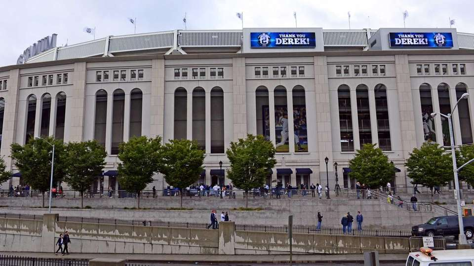 The marquee at Yankee Stadium is illuminated for