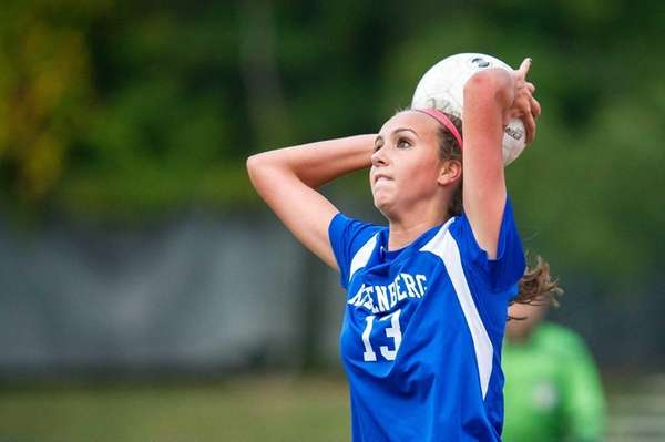 Kellenberg midfielder Daniella Fusaro throws the ball into