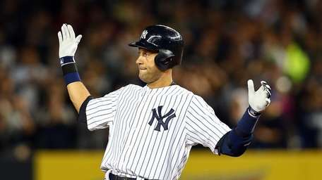 The Yankees' Derek Jeter reacts after hitting a