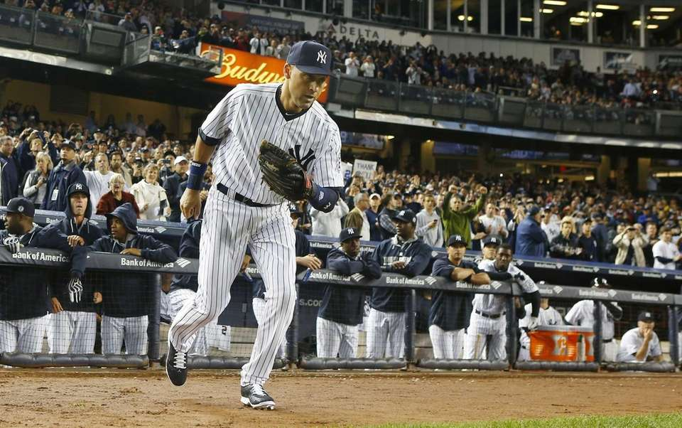 Derek Jeter of the Yankees takes the field