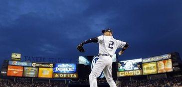 Derek Jeter of the Yankees warms up before