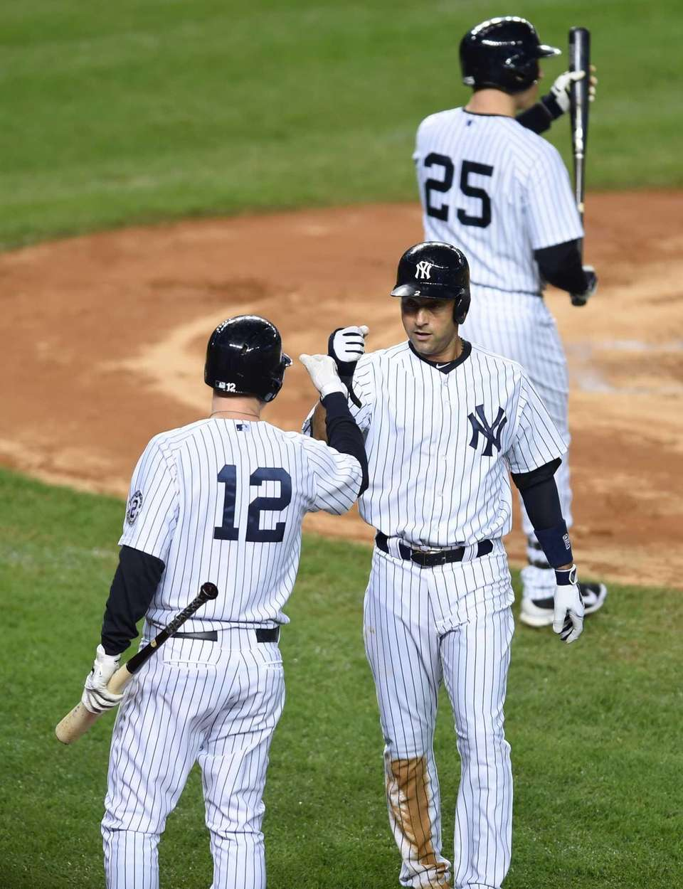 Yankees' Derek Jeter is congratulated by Chase Headley
