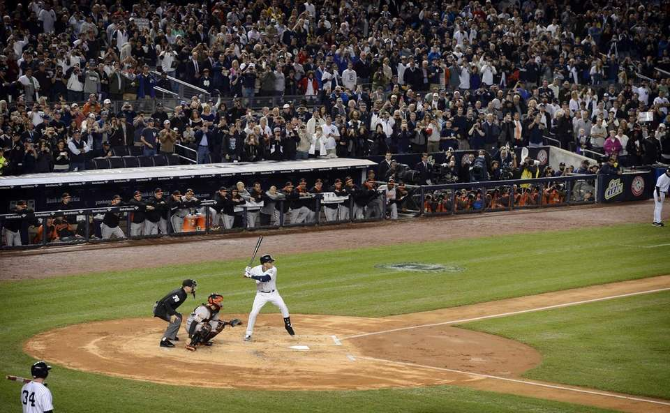 Yankees fans cheer Derek Jeter during the first