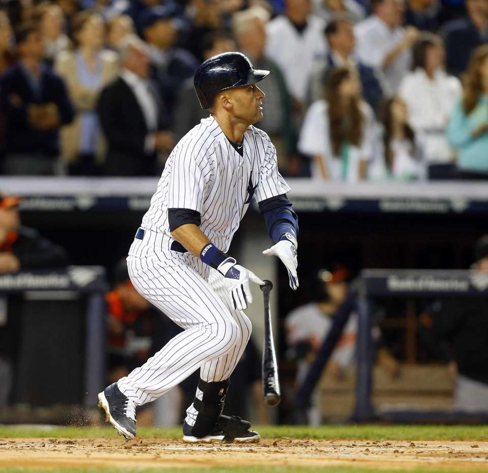Derek Jeter of the Yankees follows through on