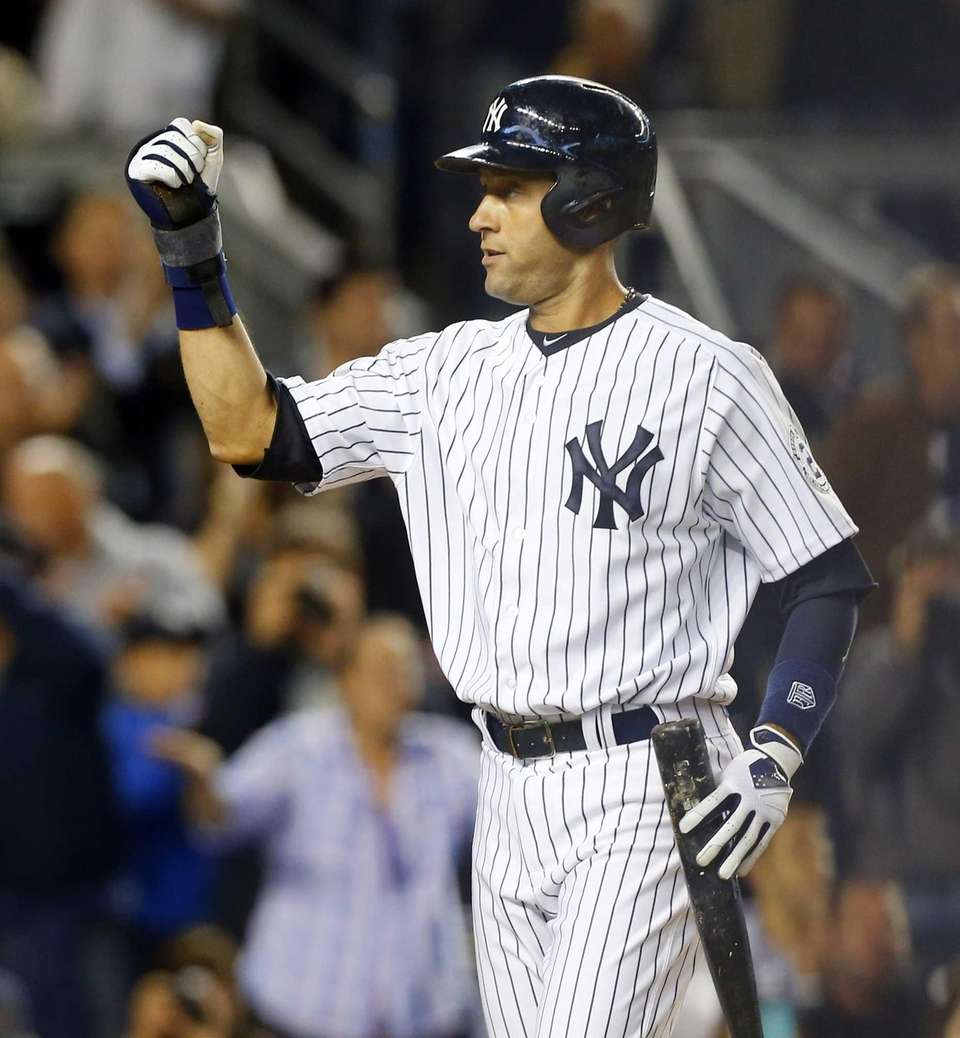 Derek Jeter of the Yankees celebrates a run