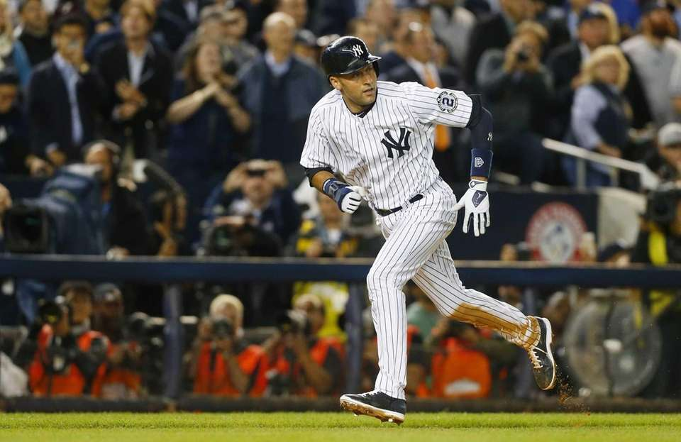 Derek Jeter of the Yankees scores a run