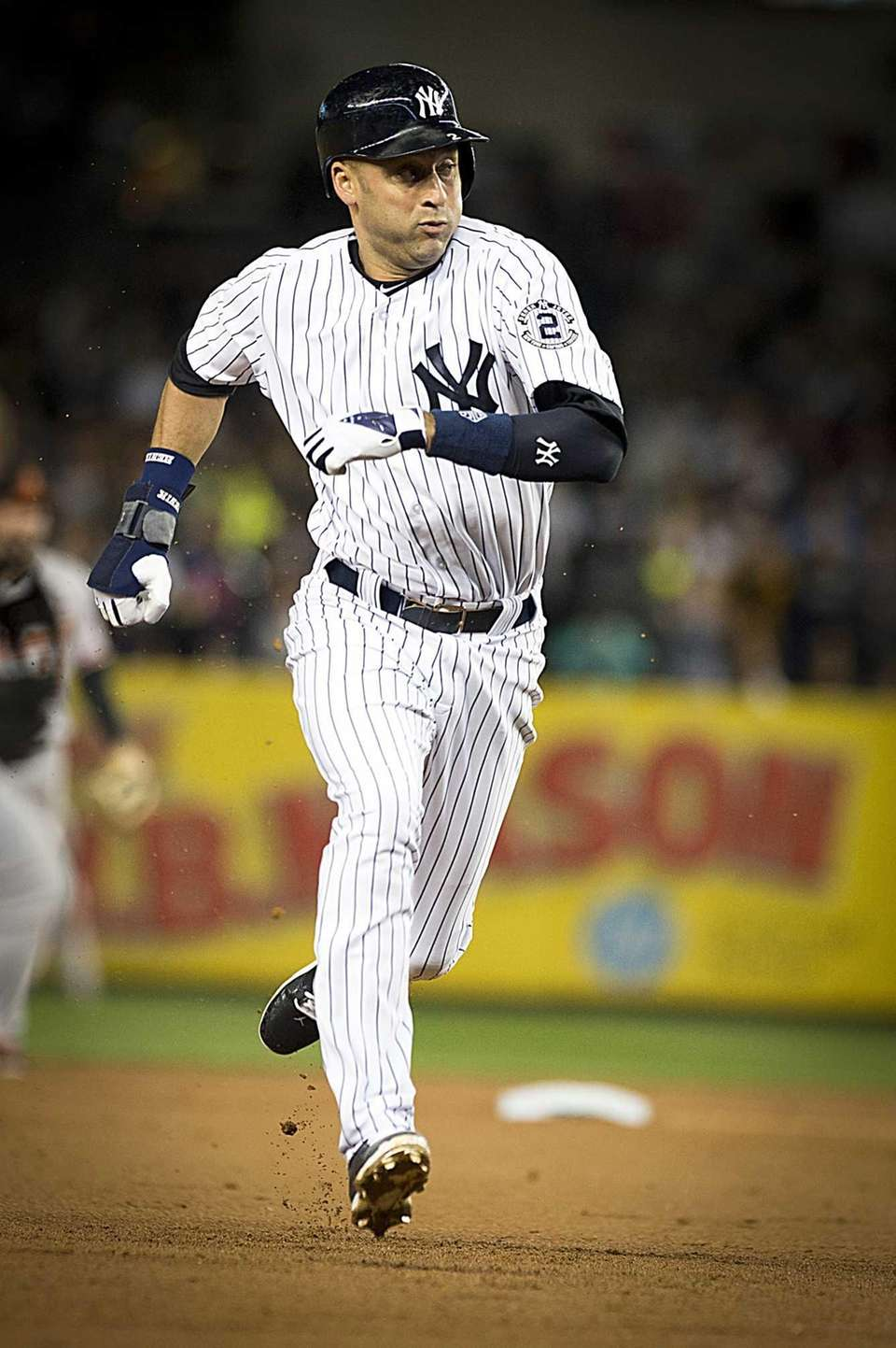 Yankees' Derek Jeter steals third base on a