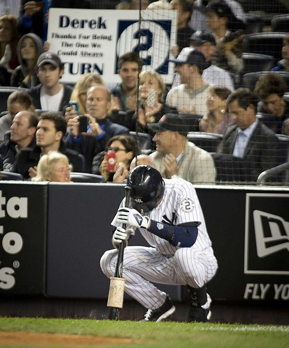 Yankees' Derek Jeter crouches before his first at-bat
