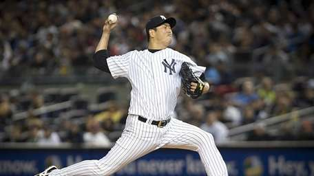 Yankees pitcher Hiroki Kuroda throws in the top