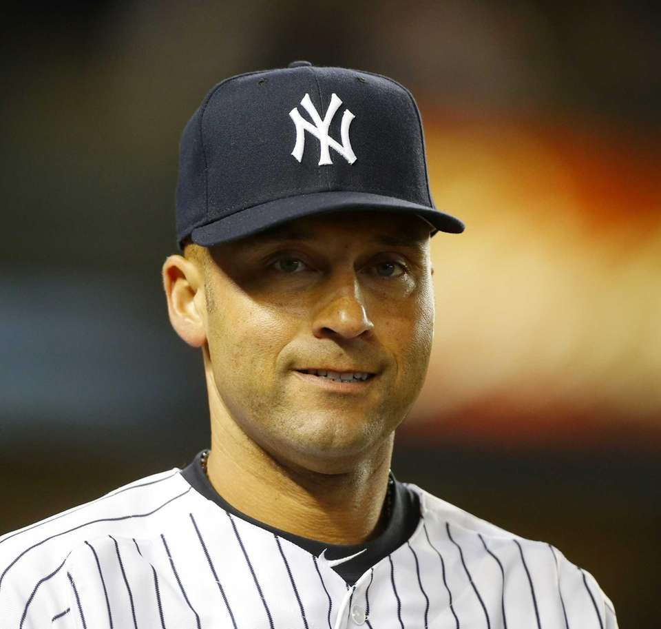 Derek Jeter of the Yankees looks on after