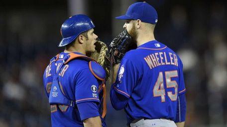 Mets starting pitcher Zack Wheeler talks with catcher