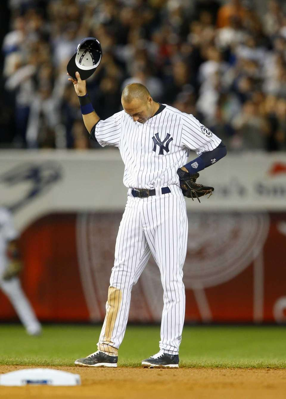 Derek Jeter of the Yankees tips his cap