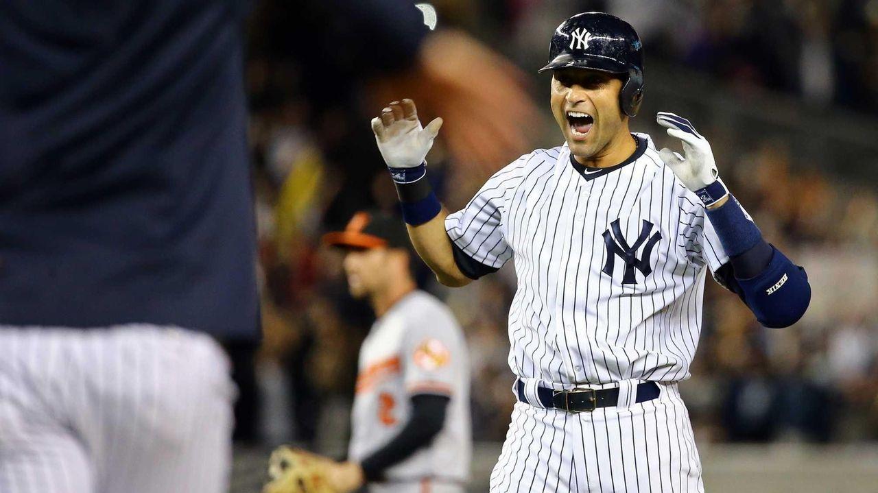 Derek Jeter of the Yankees celebrates after a