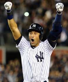 Derek Jeter of the Yankees celebrates after a