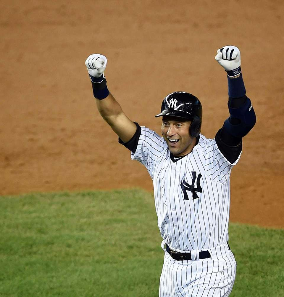 Derek Jeter of the Yankees celebrates his ninth-inning,
