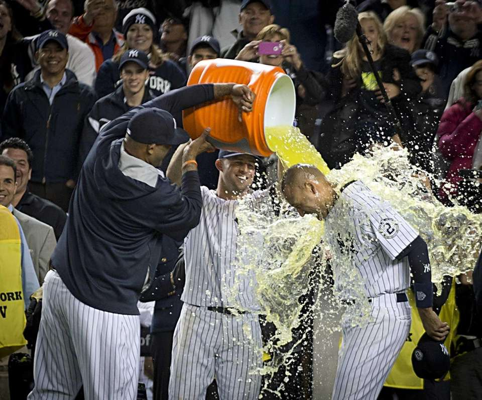 Yankees' Derek Jeter has Gatorade poured over his