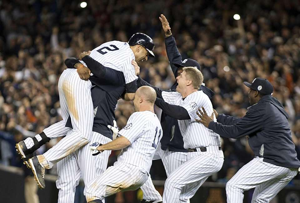 Yankees' Derek Jeter gets a big hug from