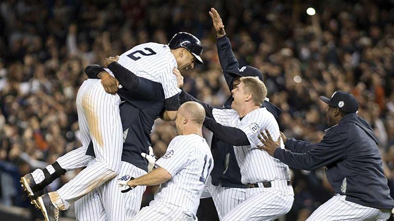 Yankees' Derek Jeter gets a big hug from