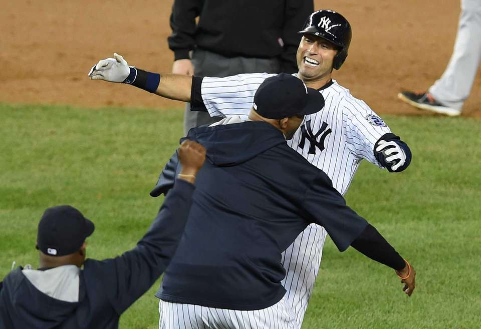 Yankees' Derek Jeter celebrates after hitting a ninth-inning,