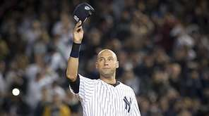 New York Yankees' Derek Jeter waves to the