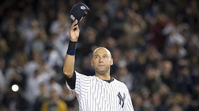 New York Yankees' Derek Jeter waves to the