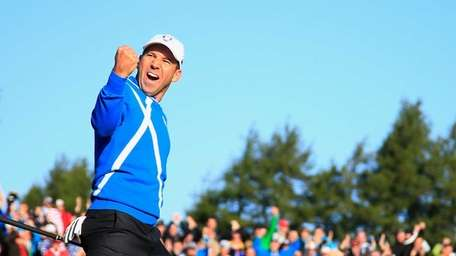Sergio Garcia of Europe celebrates after he chipped