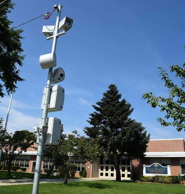 Speed cameras are shown in front of the