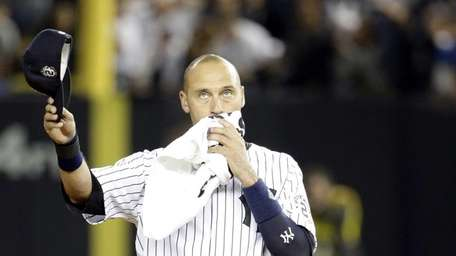 New York Yankees shortstop Derek Jeter walks on