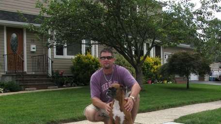 Frank DeRosa, and Lexie, with their new sidewalk