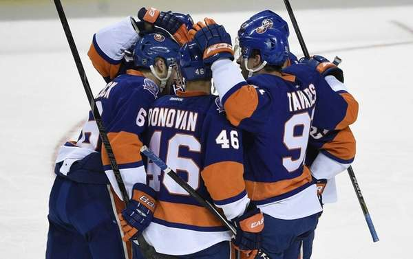 The Islanders celebrate a power play goal by