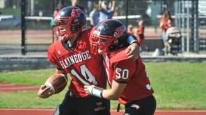 Plainedge quarterback Davien Kuinlan celebrates with Zach Gorgone