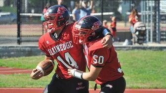 Plainedge quarterback Davien Kuinlan celebrates with Zach Gorgone