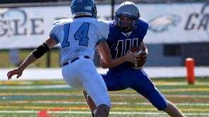 Hauppauge QB Thomas Balcom gets sacked by Rocky