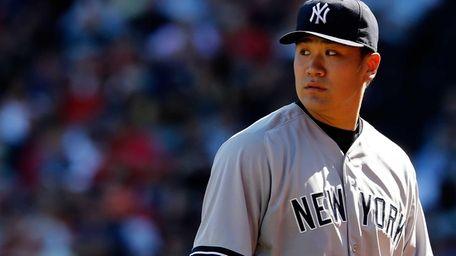 Masahiro Tanaka of the Yankees looks on against