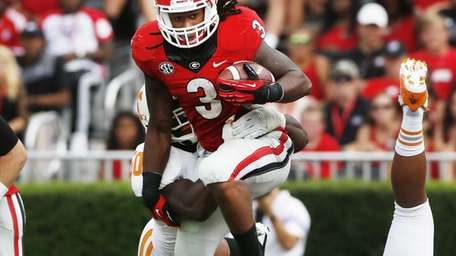 Georgia running back Todd Gurley is stopped by