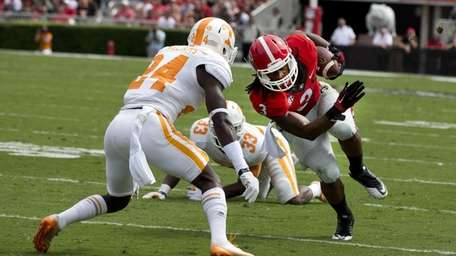 Georgia running back Todd Gurley tries to get