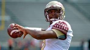 Jameis Winston of the Florida State Seminoles warms