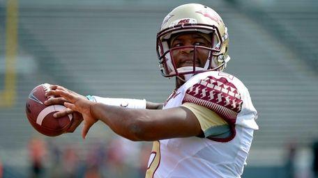 Jameis Winston of the Florida State Seminoles warms