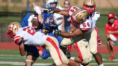West Islip's Conor Smith gets hit by Half
