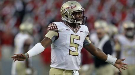 Florida State quarterback Jameis Winston (5) reacts following