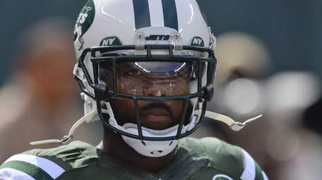 Jets wide receiver Jeremy Kerley looks on before