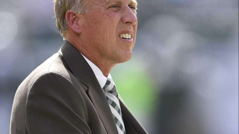 Jets GM John Idzik looks on before a
