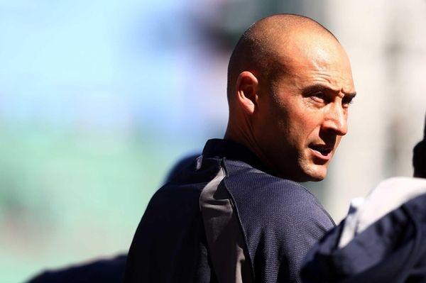 The Yankees' Derek Jeter looks on before the