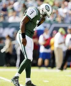 Geno Smith #7 of the Jets stands on