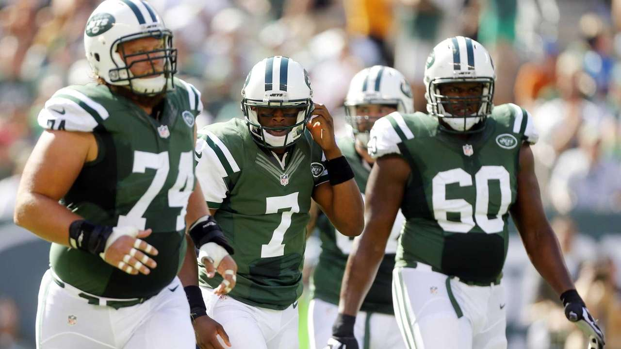 Geno Smith #7, Nick Mangold #74 and D'Brickashaw