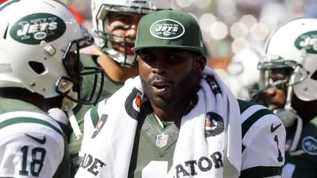 Michael Vick #1 of the Jets looks on