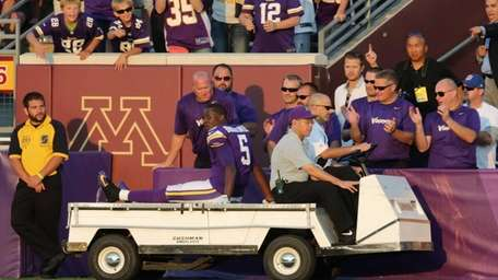 Minnesota Vikings quarterback Teddy Bridgewater is taken off