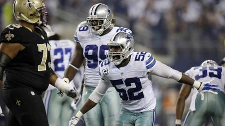 Dallas Cowboys' Justin Durant and George Selvie celebrate