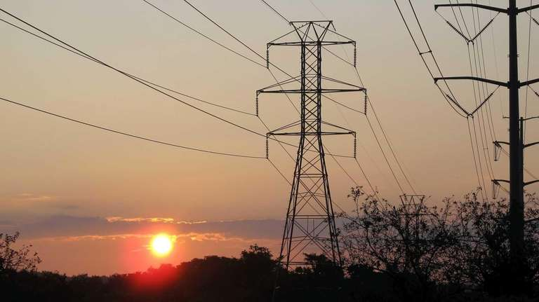 Sunrise with electric transmission lines in Melville on