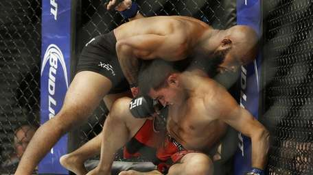 Demetrious Johnson, top, wrestles with Chris Cariaso in